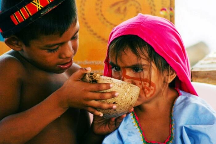 Wayuu kids drinking milk from a totuma